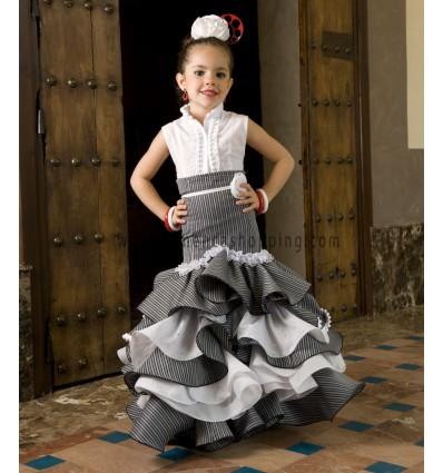 Conjunto de blusa y falda campero de niña en raya gris. 3609537b30d